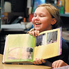 Sierra Hallam, a third grader at Valley Grove Elementary School, shows her classmate her favorite part of the story 'Two Bad Ants' out of her class reading book in Andy Raper's  class.