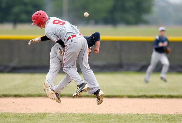 Frankton's T.J. Eads and Shenandoah's Collin Casstevens collide during sectional baseball action at Lapel on Thursday.
