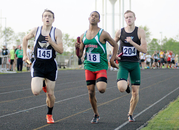 From left Mt. Vernon's Andrew Noble, Anderson's Bryant Thomas and Pendleton Height's Colby Knecht run the final leg in the 4x800 relay during the boys track sectional at Mt. Vernon High School on Thursday. Mt. Vernon finished first followed by Pendlton Heights in second and Anderson in third.