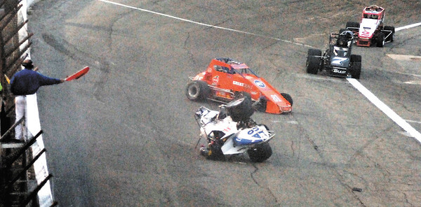 The red flag comes out on the first lap of the race as Jim Sheets hit the wall in turn 4 and flipped while Jimmy Kite got caught up in it also.  The leaders, Jo Jo Helberg, and Eric Gordon were just coming around on their 2nd lap.
