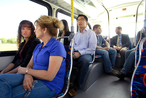 Altair Nanotechnologies employees take a ride on the EcoRide EV bus that uses their battery technology.