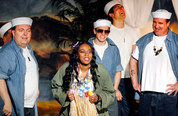 """Bloody Mary (Natasha Prim), reacts with the seabees as she tries to sell them native items in the Mainstage production of the musical """"South Pacific."""""""