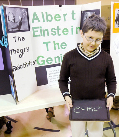 Skylar Brown, 11, portrays Albert Einstein as fifth graders from Edgewood Elementary held a living history museum on Thursday. Students spent the last month researching biographies. The project culminated in the living history museum. To purchase this photo or other photos produced by The Herald Bulletin staff, visit heraldbulletin.smugmug.com.