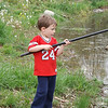 Eli Coxe fishing in his own farm pond.<br /> <br /> Photographer's Name: J.R. Rosencrans<br /> Photographer's City and State: Alexandria, Ind.