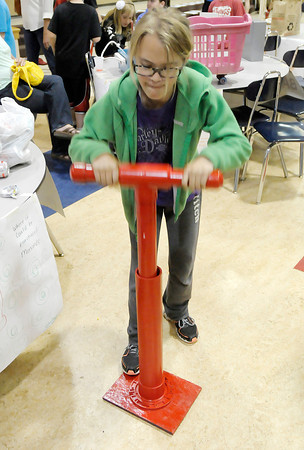 Keeton Rogers demonstrates her Can Crusher as Frankton Elementary fifth graders showed off their inventions during their annual invention convention on Thursday. To purchase this photo or other photos produced by The Herald Bulletin staff, visit heraldbulletin.smugmug.com.