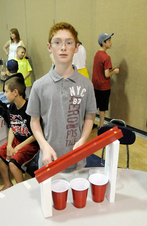 Ethan Smith created an invention to sort Lego blocks by size. Frankton Elementary fifth graders showed off their inventions during their annual invention convention on Thursday. To purchase this photo or other photos produced by The Herald Bulletin staff, visit heraldbulletin.smugmug.com.