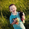 My grandson Asher Ayers playing in the tall grass.<br /> <br /> Photographer's Name: Terry Lynn  Ayers<br /> Photographer's City and State: Anderson, Ind.
