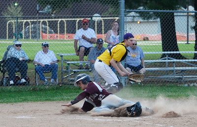 Erica Miller @togianphotog - The Saratogian:    On Monday afternoon at Veteran's Park, Saratoga Central Catholic hosted baseball game to Fort Plains, both undefeated. Fort Plain's Drew Fureno slides safely into home plate past Saint's Ryan Czarnecki.