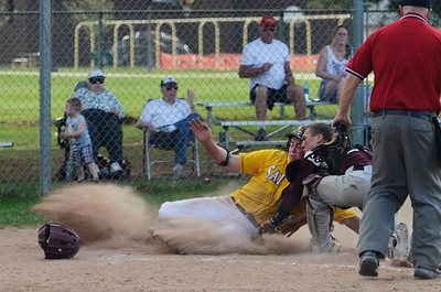 Erica Miller @togianphotog - The Saratogian:    On Monday afternoon at Veteran's Park, Saratoga Central Catholic hosted baseball game to Fort Plains, both undefeated. Saint's Tim Brizzell slides safely into home plate.