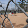 Baseball through the fence.<br /> <br /> Photographer's Name: Linda Dickey<br /> Photographer's City and State: Anderson, Ind.