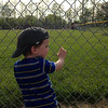 This is Bennett Sovern, age 23 months, watching his cousin play softball in Alexandria.<br /> <br /> Photographer's Name: Carrie Long<br /> Photographer's City and State: Alexandria, Ind.
