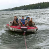 My friends 'catching air' on a Mother's Day tubing ride at Geist Reservoir.<br /> <br /> Photographer's Name: Jerry Byard<br /> Photographer's City and State: Anderson, Ind.