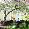 5-2-13<br /> Designer showhome<br /> Casey Goodman and Brannon Harrison work on the landscaping in front of Mulberry Street's Designers' Showhome.<br /> KT photo | Kelly Lafferty