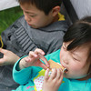 5-4-13<br /> Family Fun day at the fairgrounds<br /> 5-year-old Fiona Lam and her 8-year-old brother Aden Lam, try their first s'more at the Howard County Fairgrounds during Family Fun Day.<br /> KT photo | Kelly Lafferty
