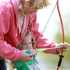 5-4-13<br /> Family Fun day at the fairgrounds<br /> Ann Powell helps her granddaughter Hayleigh Hosler, 3, with her bow at an archery station at the Howard County Fairgrounds during family fun day.<br /> KT photo | Kelly Lafferty