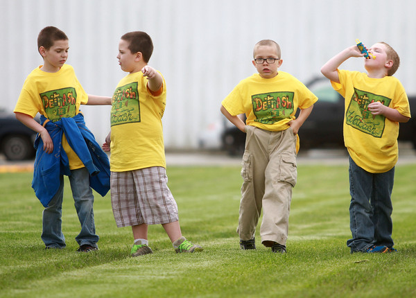 5-4-13<br /> Family Fun day at the fairgrounds<br /> From left: Lucas Dunham, Lucis Shipp-Baum, Ian Hook, and Gabe Dunham line up to begin a race during Family Fun Day at the Howard County Fairgrounds.<br /> KT photo | Kelly Lafferty