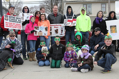 17Mar2013__ Marchers of the Pooch Patrol gather around the Danicki Family in the Amherst Library Parking lot, after the March for Maya. The Danicki's dog, Maya was stabbed to death last week. photo by Ray Riedel