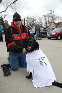 """17Mar2013__ Tony Kelly with his dog """"Buddy"""" in the Amherst Library parking lot before the Pooch Patrol march for Maya on Sunday March 17. photo by Ray Riedel"""