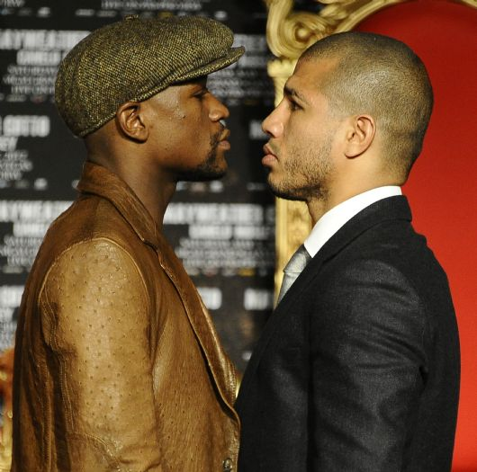 . Floyd Mayweather Jr.(L) faces poses with Miguel Cotto during a press conference at Grauman\'s Chinese Theater. The two will fight May 5th in Las Vegas at the MGM grand hotel. Hollywood CA.  March 1,2012. Photo by Gene Blevins/LA Daily News