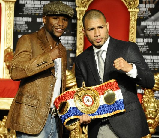 . Floyd Mayweather Jr.(L) poses with Miguel Cotto during a press conference at Grauman\'s Chinese Theater. The two will fight May 5th in Las Vegas at the MGM grand hotel. Hollywood CA.  March 1,2012. Photo by Gene Blevins/LA Daily News