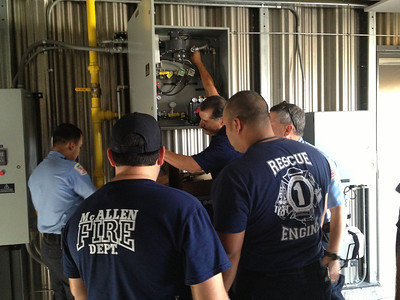 McAllen firefighters familiarize themselves with training capabilities and safety features of new Drill Tower.