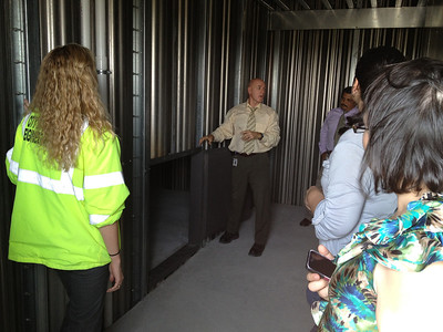 City project engineer tours facility with city staff.  Space to the left is an attic opening for firefighters to train in crawl spaces and for attic rescues.