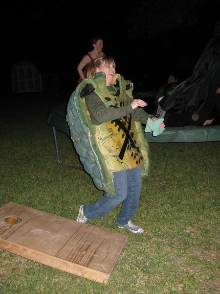 Deena attempting corn hole in her tortoise shell