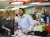 P1.1 Quicken Photo for Chapter 1 Opener<br /> <br /> Choice 1 of 15<br /> <br /> Quicken Loans mortgage banker Seth Poles laughs while shooting toy guns at co-workers as he takes a call at the Quicken Loans office at the Chase Tower in downtown Detroit. The creative workspace that offers employees fun things to do while working has helped employees do their part as Quicken Loans has risen very quickly to become the third largest mortgage lender in the nation.