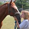 Stephanie A and her quarter horse Buddy.