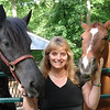 Karyn O. with her Friesan mare Gina and her quarter horse gelding, Skip.