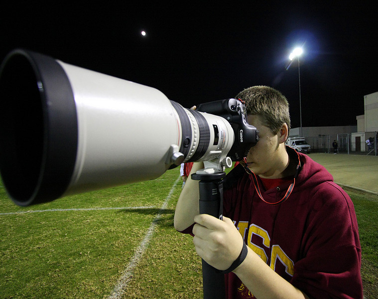 Me with Dan MacLeith's(my school's football announcer) Canon 1D Mark III and Canon 300mm 2.8L IS and Gitzo Carbon Fibor Mono-pod<br /> <br /> -Photo Courtesy of Nam Luong