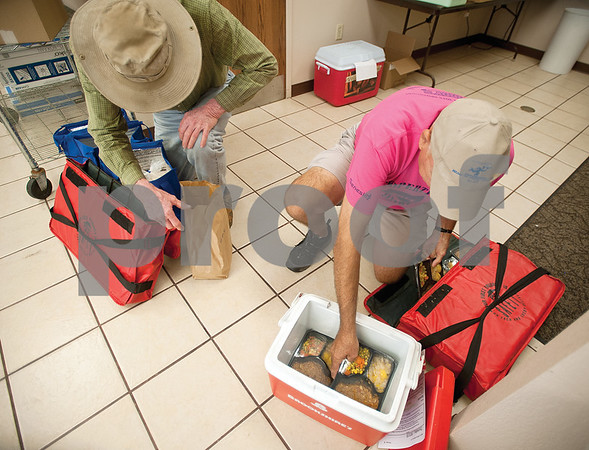Meals on Wheels Ministry volunteer Decker Kennington, right, packs his meals in a cooler before he starts his route in Tyler Thursday morning.   (Sarah A. Miller/Tyler Morning Telegraph)