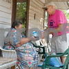 Meals on Wheels Ministry volunteer Decker Kennington, right, delivers food to client Trinny Warren at her home in Tyler Thursday morning. <br /> <br /> (Sarah A. Miller/Tyler Morning Telegraph)