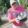 Meals on Wheels Ministry volunteer Decker Kennington,  delivers food to client Trinny Warren at her home in Tyler Thursday morning. <br /> <br /> (Sarah A. Miller/Tyler Morning Telegraph)