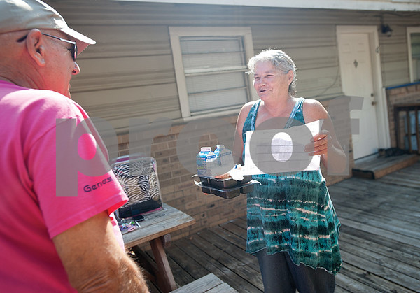 Meals on Wheels Ministry volunteer Decker Kennington,  delivers food to client Alice Raymond at her home in Tyler Thursday morning.   (Sarah A. Miller/Tyler Morning Telegraph)