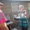 Meals on Wheels Ministry volunteer Decker Kennington,  delivers food to client Alice Raymond at her home in Tyler Thursday morning. <br /> <br /> (Sarah A. Miller/Tyler Morning Telegraph)