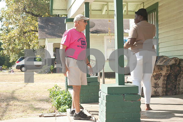 Meals on Wheels Ministry volunteer Decker Kennington,  delivers drops off food at Natasha Hinton's Tyler home Thursday morning.   (Sarah A. Miller/Tyler Morning Telegraph)