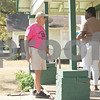 Meals on Wheels Ministry volunteer Decker Kennington,  delivers drops off food at Natasha Hinton's Tyler home Thursday morning. <br /> <br /> (Sarah A. Miller/Tyler Morning Telegraph)
