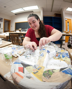 Making masks for use in production of The People's History theater production. The masks are being created in Dreiser Hall