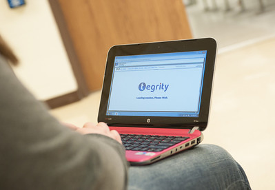 Nursing student using Tegrity software on netbook laptop in Nursing Building