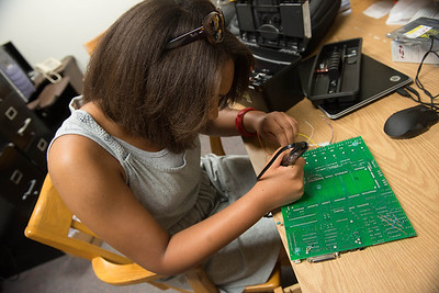 A group of five students creating a customizable microcontroller board and a new user interface program that can allow different components used in automobiles to be connected and used.