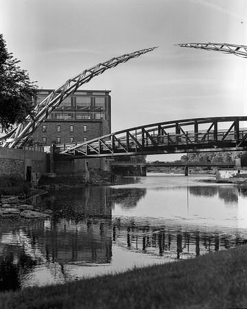 Three Bridges and an Arc