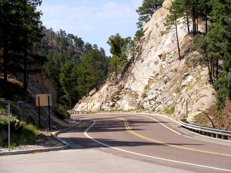 A view of the windy (as in curvy) road and the entrance of the trailhead parking lot.