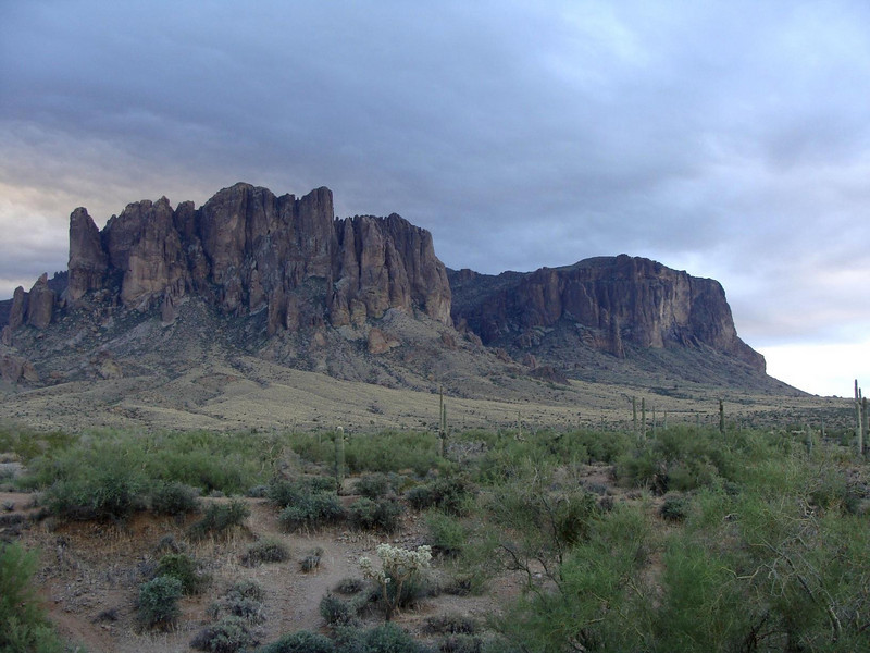 A view of the Superstition Mountains from the trailhead.  The trail will take us through that dark cleft in the middle of the mountains in this picture.