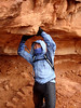 Erica holds up a red-rock overhang so that the rest of us can pass safely underneath it. :-D