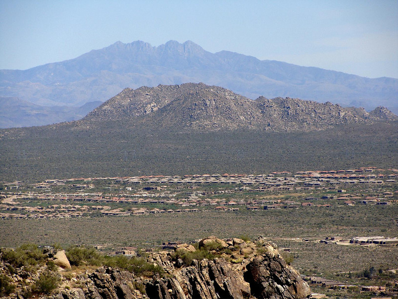 This isn't the best picture, but will do for now.  This picture shows Four Peaks as seen (with extreme zoom) from the summit of Black Mountain in Cave Creek.  Browns Peak is the one to the far left.  It looks kind of small and shorter than the others from here, but its just the angle.  It's actually a little farther back and taller than the others.