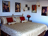 """This was my room.  The Hollywood Room.  All new bedding, pictures of classic movie stars on the walls, and each room had a microwave, mini fridge, and a new 26"""" or 32"""" HD flatscreen TV.  Very nice for just $55 a night."""