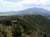 Getting near the summit and the fire tower.  Looking back across the ridge on Kendrick Mountain, with the San Francisco Peaks in the background.