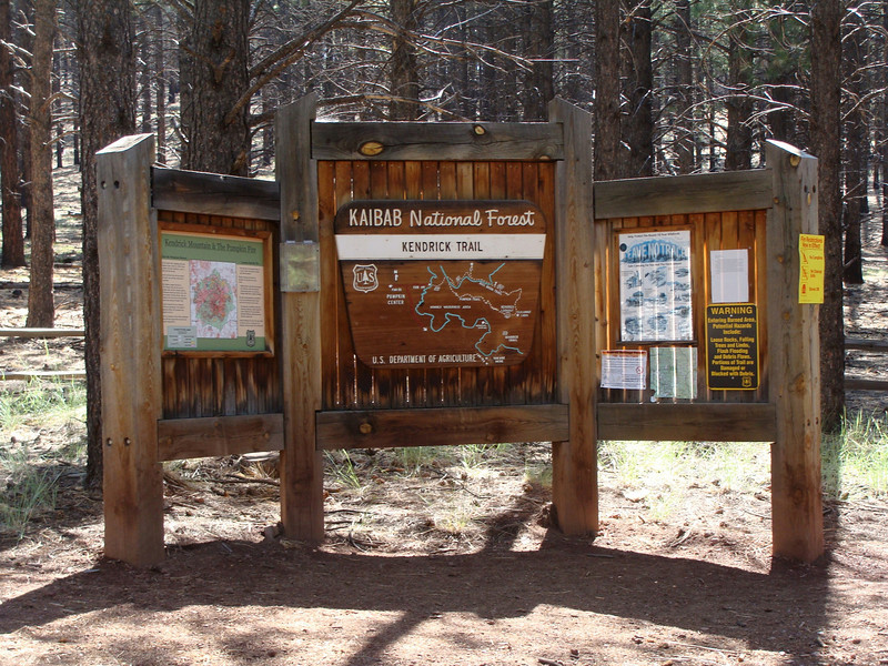 Signs and notices at the trailhead.