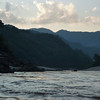 View of the Mekong shore from the boat toward dusk